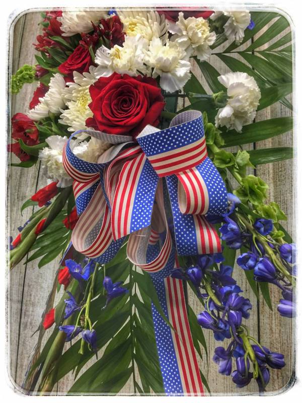 Funeral Flowers - Red, White & Blue Patriotic Funeral Spray by Petals Flower Shop & Florist