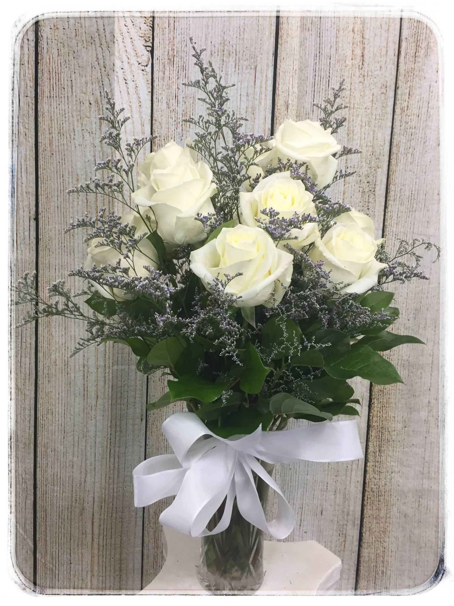 Arctic white roses petals flower shop florist white rose flower arrangement by petals flower shop florist mightylinksfo