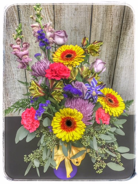 Wave To The Wind Spring Flower Collection by Petals. Locally Owned, 5 Star Florist. Order Online, Same Day Delivery. Free Personalization with every order.